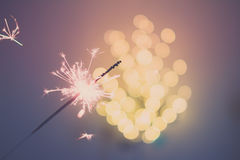 Sparklers and bokeh. Invoking the holidays with sparklers and a light bokeh Royalty Free Stock Photo