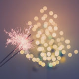 Sparklers and bokeh. Invoking the holidays with sparklers and a light bokeh Royalty Free Stock Image