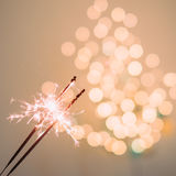 Sparklers and bokeh. Invoking the holidays with sparklers and a light bokeh Stock Image