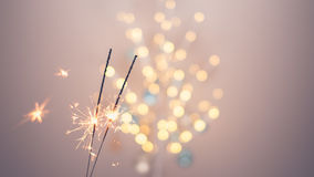 Sparklers and bokeh. Invoking the holidays with sparklers and a light bokeh Stock Photo