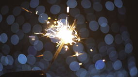 Sparklers burn at the background of the city. stock footage