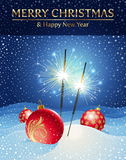Sparklers and Christmas baubles in snowdrift. Stock Images