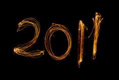 Sparklers di nuovo anno 2011 isolati sul nero Immagine Stock Libera da Diritti