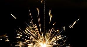 Sparklers fire sparks. Fireworks sparks of sparklers on black background Stock Photo