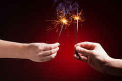 Sparklers in hands Stock Photography