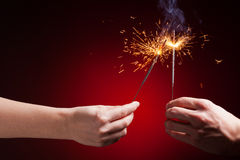 Sparklers in hands Stock Images