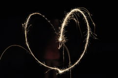 Sparklers. Kids with sparklers making heart shapes with sparklers Stock Image