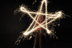Sparklers. Kids with sparklers making star shapes with sparklers Stock Image