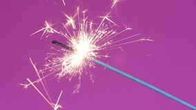 Sparklers over a pink stock footage