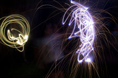 Sparklers. Time lapse photo of two kids playing with sparklers on the 4 of July stock photo
