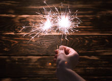 Sparklers in woman hands Stock Photo