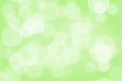 Sparkles borrados do verde fotografia de stock