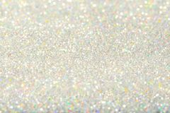 Sparkles Light Background, De Focused Sparkling Silver Dust. Defocused Bokeh Stock Photography