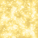 Sparkles, light on yellow background. Stock Image