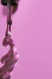 Sparkles nails polish isolated on soft pink background.Stylish Nails, Nailpolish Stock Image