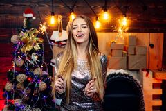 Sparkles party, Bengal lights. Christmas interior. Funny christmas girl. Winter holidays and people concept. True. Emotions. Funny. Having fun. Funny Laughing royalty free stock image