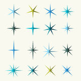 Sparkles Symbols Various Shades on White Background Stock Image