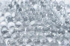 Sparkles translucent through colorless hydrogel. Abstract background of sparkles translucent through colorless hydrogel balls stock image