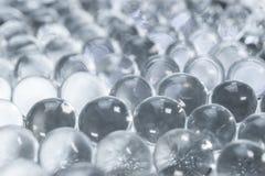 Sparkles translucent through colorless hydrogel. Abstract background of sparkles translucent through colorless hydrogel balls stock images