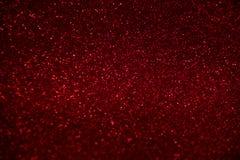Sparkles vermelhos abstratos dos confetes do brilho no fundo preto ilustração royalty free
