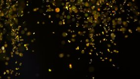 Sparkles in water. Golden glitter paint in water, abstract cloud formations on black background. Can be used as gloss. Transitions, added to art modern projects stock video footage