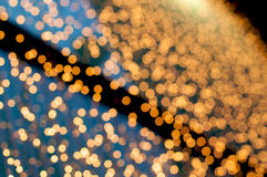 Sparkling. Defocus of golden lights. Christmas abstract background Stock Photos