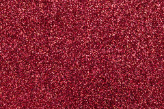 Sparkling background of red sparkles closeup. Royalty Free Stock Images