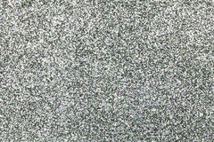 Sparkling background of silver sparkles closeup. stock images