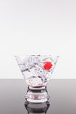 Sparkling beverage in a martini glass with cherry Royalty Free Stock Photo