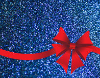 Sparkling blue background with red bow Stock Images