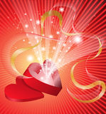 Sparkling box. Red open box in the shape of a heart from which flows a flickering light Stock Images