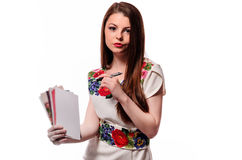 Sparkling businesswoman holding a notebook isolated on a white background Royalty Free Stock Photo