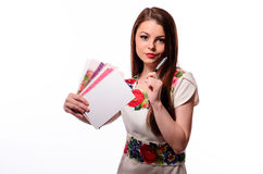 Sparkling businesswoman holding a notebook isolated on a white background Royalty Free Stock Photos