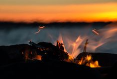 Sparkling campfire and sunset lake Stock Images