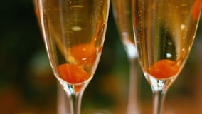 Sparkling champagne flutes on tray with cherry stock video footage