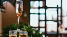 Sparkling champagne flutes on tray with cherry stock footage