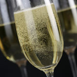 Sparkling Champagne over black background Royalty Free Stock Images