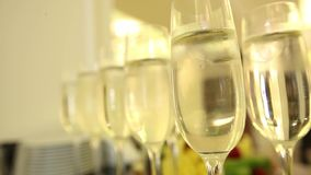 Sparkling champagne wine in glasses in front of the warm fireplace. Close up. Sparkling champagne wine in glasses in front of the warm fireplace stock video