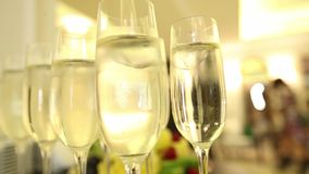 Sparkling champagne wine in glasses in front of the warm fireplace. Close up. Sparkling champagne wine in glasses in front of the warm fireplace stock footage