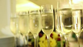 Sparkling champagne wine in glasses in front of the warm fireplace. Close up. Sparkling champagne wine in glasses in front of the warm fireplace stock video footage