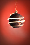 Sparkling christmas ball. A christmas ball with a sparkling light effect Stock Image