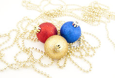 Sparkling Christmas balls and golden beads Stock Images