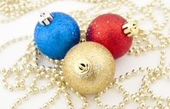 Sparkling Christmas balls and golden beads Stock Image