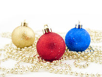 Sparkling Christmas balls and golden beads Stock Photo