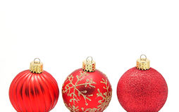 Sparkling Christmas Balls Row. Three red and gold glass Christmas ornaments in a row Stock Image