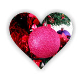 Sparkling Christmas bauble inside a heart shape stock images