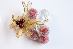 Sparkling Christmas Berries. A Christmas tree ornament consisting of fosted berries,, glass baubles & gold metallic ribbon Royalty Free Stock Photo