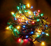 Sparkling Christmas garland. The sparkling Christmas garland on a background Royalty Free Stock Photos