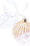Sparkling Christmas Golden ball on white background, festive dec Royalty Free Stock Photos