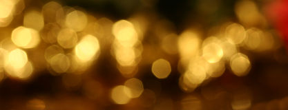 Sparkling Christmas lights. Pattern of defocus of golden lights Royalty Free Stock Photo